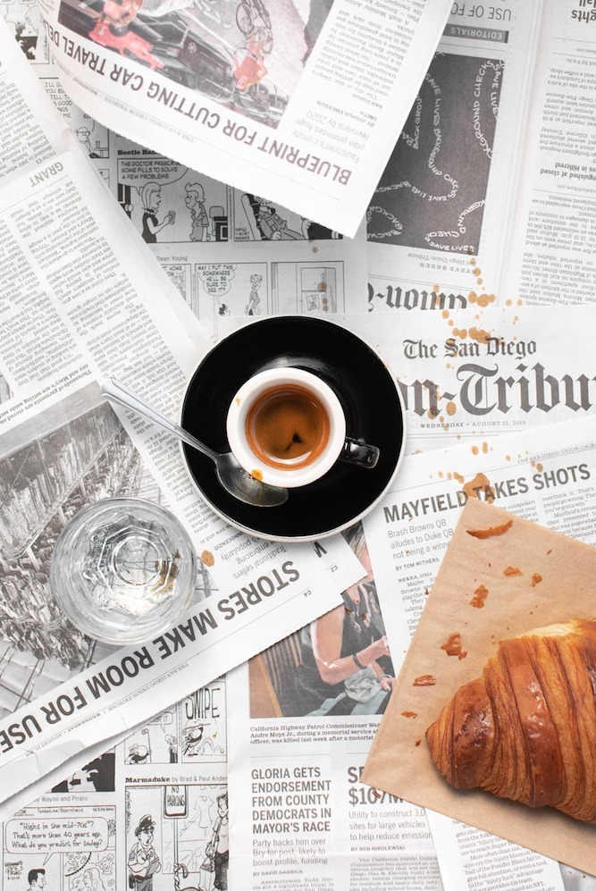 A shot of The WestBean espresso on a pile of San Diego Union Tribune pages